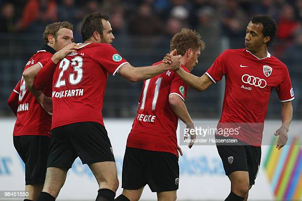Moritz Hartmann of Ingolstadt celebrates scoring the opening goal with his team mates Steffen Wohlfahrt , Andreas Neuendorf and Moise Bambara during...