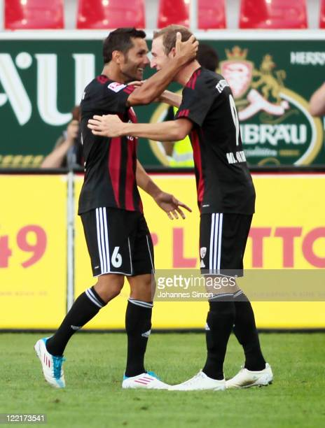 Moritz Hartmann of Ingolstadt celebrates with team mate Stefan Leitl after scoring his team's first goal during the Second Bundesliga match between...