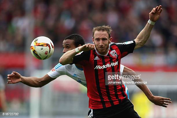 Moritz Hartmann of Ingolstadt fights for the ball with Joel Matip of Schalke during the Bundesliga match between FC Ingolstadt and FC Schalke 04 at...