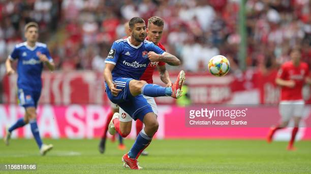 Moritz Heinrich of SpVgg Unterhaching challenges Florian Pick of 1FC Kaiserslautern during the 3 Liga match between 1 FC Kaiserslautern and SpVgg...
