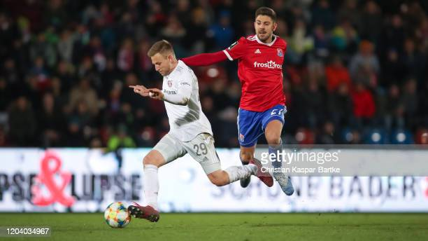 Moritz Heinrich of SpVgg Unterhaching tackles Timo Kern of FC Bayern Muenchen II during the 3. Liga match between SpVgg Unterhaching and Bayern...