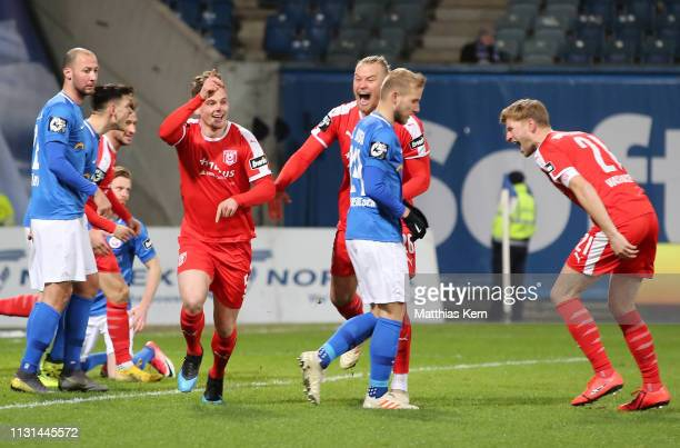 Moritz Heyer of Halle celebrates after scoring his team's first goal during the 3 Liga match between FC Hansa Rostock and Hallescher FC at...