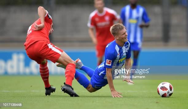 Moritz Heyer of Hallescher FC and Maximilian Mittelstaedt of Hertha BSC during the game between Hertha BSC and Hallescher FC at the Amateurstadion on...