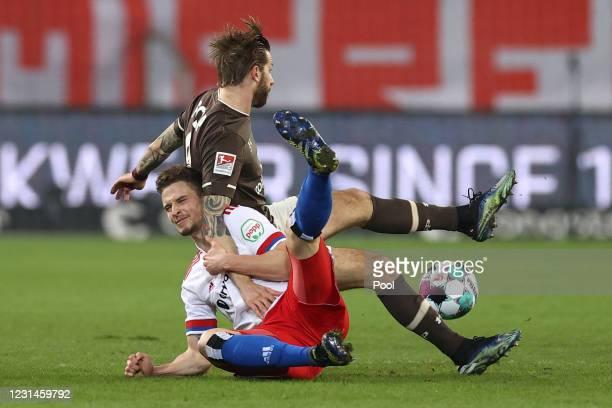Moritz Heyer of Hamburg and Guido Burgstaller of FC St. Pauli battle for the ball during the Second Bundesliga match between FC St. Pauli and...