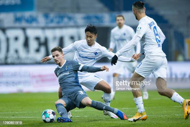 Moritz Heyer of Hamburg is challenged by Seung-ho Paik of Darmstadt during the Second Bundesliga match between SV Darmstadt 98 and Hamburger SV at...