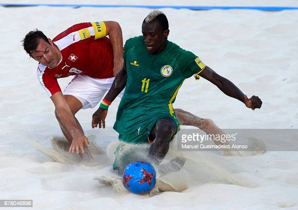 Moritz Jaeggy of Switzerland competes for the ball with Ibrahima Balde of Senegal during the FIFA Beach Soccer World Cup Bahamas 2017 group A match...