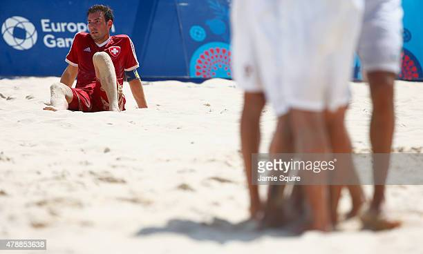 Moritz Jaeggy of Switzerland looks dejected in defeat after the Men's Beach Soccer bronze medal match between Switzerland and Portugal on day sixteen...