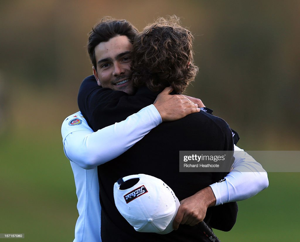Moritz Lampert of Germany is congratulated by his caddy after he secures his card during the final round of the European Tour Qualifying School Finals at PGA Catalunya Resort on November 29, 2012 in Girona, Spain.