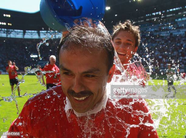 Moritz Leitner of Augsburg pours water over his head coach Jos Luhukay after the Second Bundesliga match between FC Augsburg and FSV Frankfurt at...
