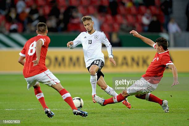 Moritz Leitner of Germany and Fabian Schaer of Switzerland battle for the ball during the Under 21 European Championship Play Off match between...