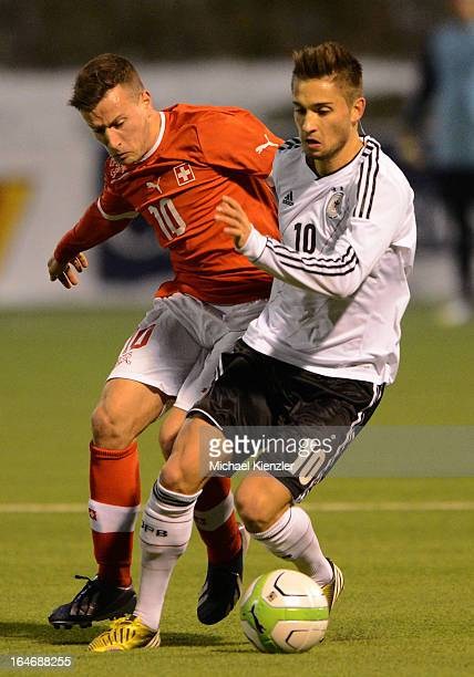 Moritz Leitner of Germany challenges Mergim Brahimi during the international friendly match between U20 Switzerland and U20 Germany at Eps Stadium on...