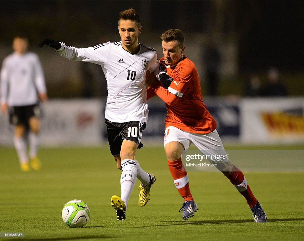 Moritz Leitner (L) of Germany challenges Mergim Brahimi of Switzerland during the international friendly match between U20 Switzerland and U20 Germany at Eps Stadium on March 26, 2013 in Baden, Switzerland