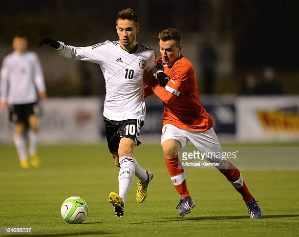 Moritz Leitner of Germany challenges Mergim Brahimi of Switzerland during the international friendly match between U20 Switzerland and U20 Germany at...