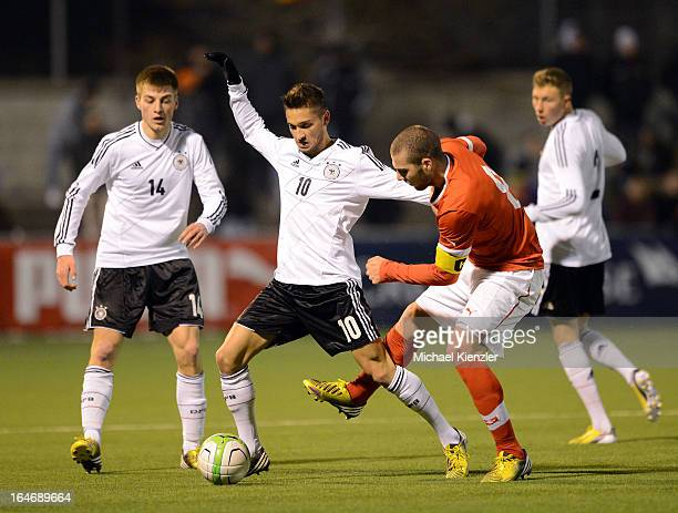 Moritz Leitner of Germany challenges Pajtim Kasami of Switzerland during the international friendly match between U20 Switzerland and U20 Germany at...