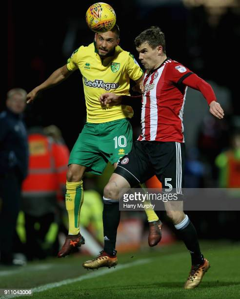 Moritz Leitner of Norwich City and Andreas Bjelland of Brentford vie for the ball during the Sky Bet Championship match between Brentford and Norwich...
