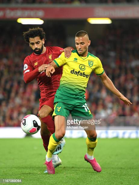 Moritz Leitner of Norwich City and Mohamed Salah of Liverpool during the Premier League match between Liverpool FC and Norwich City at Anfield on...