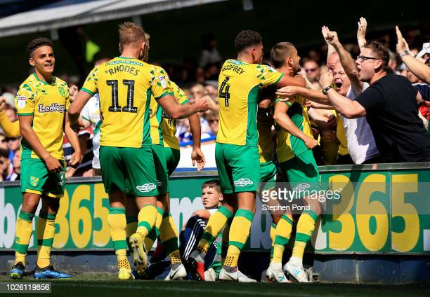Moritz Leitner of Norwich City celebrates after scoring his team's first goal with team mates and fans during the Sky Bet Championship match between...