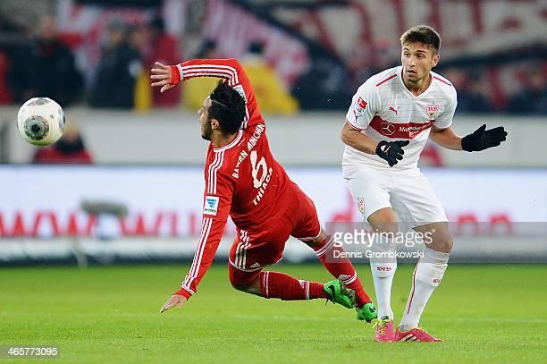 Moritz Leitner of VfB Stuttgart challenges Thiago of FC Bayern Muenchen during the Bundesliga match between VfB Stuttgart and FC Bayern Muenchen at...