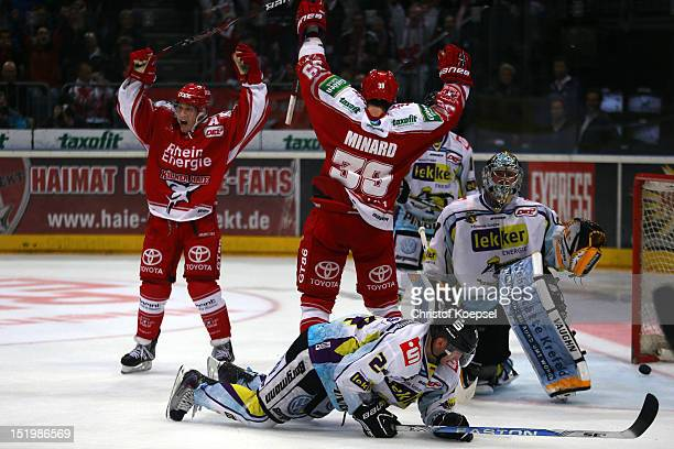 Moritz Mueller and Christopher Minard of Koelner Haie celebrate the second goal during the DEL match between Koelner Haie and Krefeld Pinguine at...
