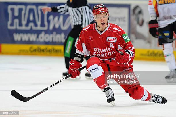 Moritz Mueller of Cologne celebrates after scoring his team's second goal during the DEL match between Koelner Haie and DEG Metro Stars at Lanxess...
