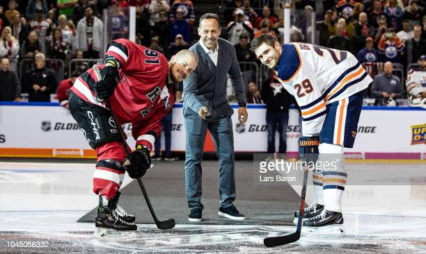 Moritz Mueller of Haie and Leon Draisaitl of Edmonton are seen with german national coach Marco Sturm during the NHL Global Series Challenge game...