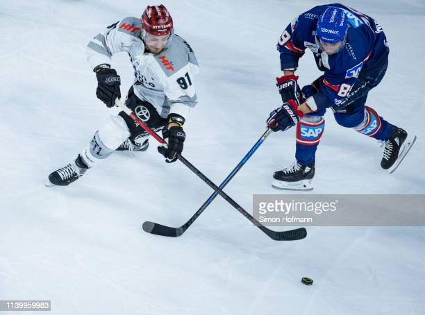 Moritz Mueller of Koeln is challenged by David Wolf of Mannheim during game one of the DEL PlayOffs Semi Final between Adler Mannheim and Koelner...