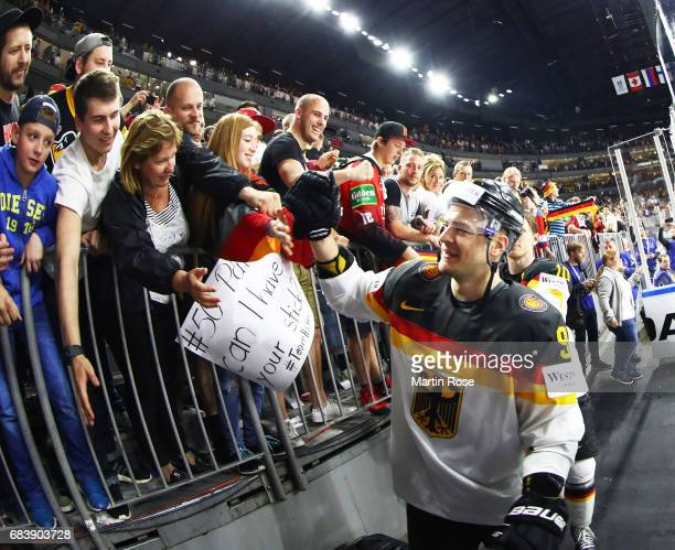Moritz Muller of Germany celebrates victory with fans after the Germany v Latvia match of the 2017 IIHF Ice Hockey World Championships at Lanxess...