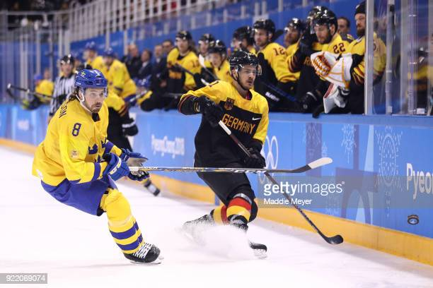 Moritz Muller of Germany controls the puck against Johan Fransson of Sweden during the Men's Playoffs Quarterfinals game on day twelve of the...