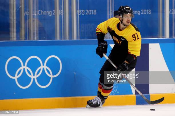 Moritz Muller of Germany controls the puck in the first period against Norway during the Men's Ice Hockey Preliminary Round Group B game on day nine...