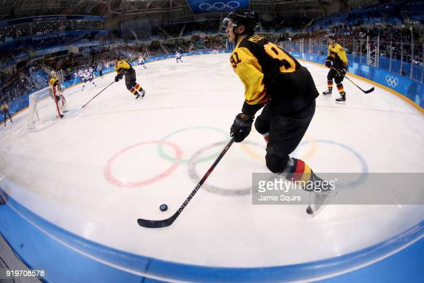 Moritz Muller of Germany controls the puck in the second period against Norway during the Men's Ice Hockey Preliminary Round Group B game on day nine...