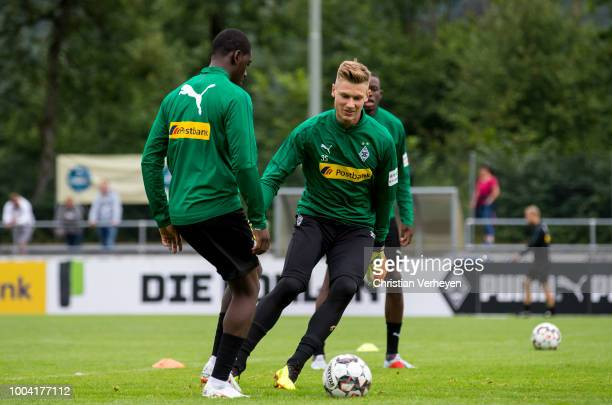 Moritz Nicolas and Mamadou Doucoure battle for the ball during a Training Session at Borussia Moenchengladbach Training Camp at Stadion am Birkenmoos...