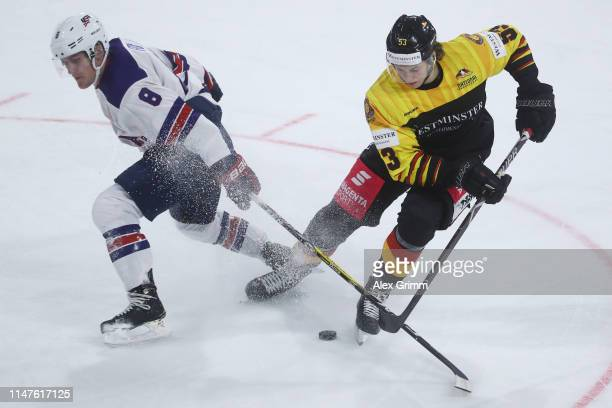 Moritz Seider of Germany is challenged by Adam Fox of USA during the international friendly game between Germany and USA ahead of the 2019 IIHF Ice...