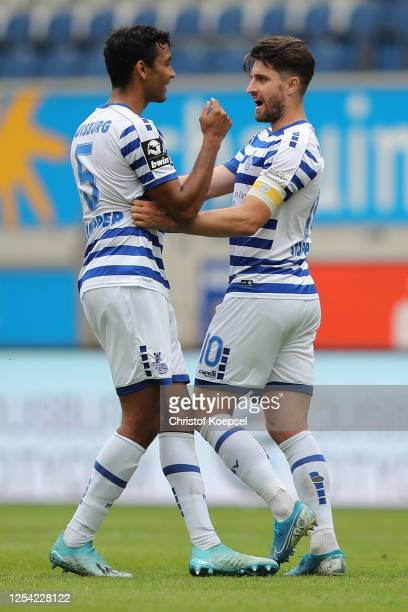 Moritz Stoppelkamp of Duisburg celebrates the forth goal with Marvin Compper of Duisburg during the 3 Liga match between MSV Duisburg and SpVgg...