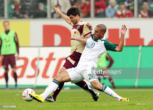 Moritz Stoppelkamp of Hannover battles for the ball with Ashkan Dejagah of Wolfsburg during the Bundesliga match between VFL Wolfsburg and Hannover...