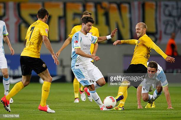 Moritz Stoppelkamp of Muenchen fights for the ball with Idir Ouali and Filip Trojan of Dresden during the Second Bundesliga match between SG Dynamo...