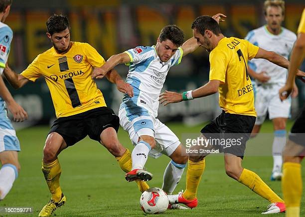 Moritz Stoppelkamp of Muenchen fights for the ball with Idir Ouali and Giannis Papadopoulos of Dresden during the Second Bundesliga match between SG...