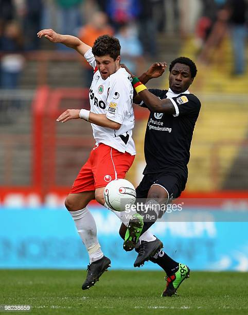 Moritz Stoppelkamp of Oberhausen and Georges Mandjeck of Kaiserslautern battle for the ball during the Second Bundesliga match between RotWeiss...