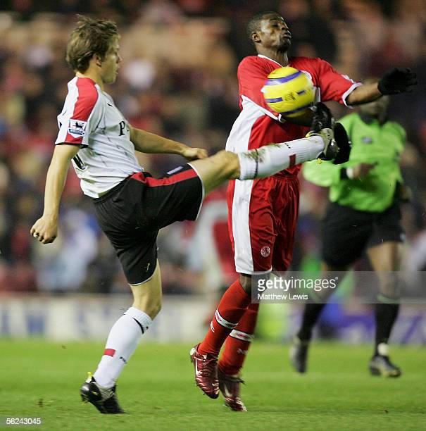 Moritz Volz of Fulham and George Boateng of Middlesbrough challenge for the ball during the Barclays Premiership match between Middlesbrough and...