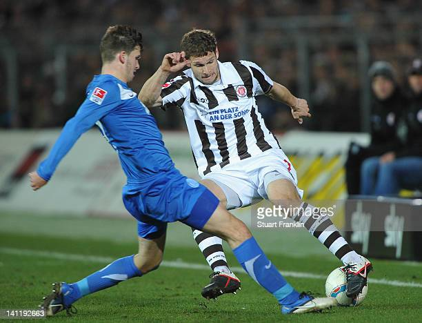Moritz Volz of St Pauli is challenged by Pascal Gross of Karlsruher during the second Bundesliga match between St Pauli and Karlsruher SC at the...