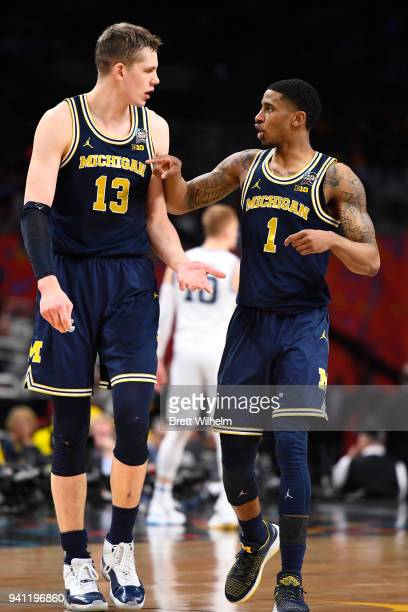 Moritz Wagner and Charles Matthews of the Michigan Wolverines talk during the first half of the 2018 NCAA Photos via Getty Images Men's Final Four...