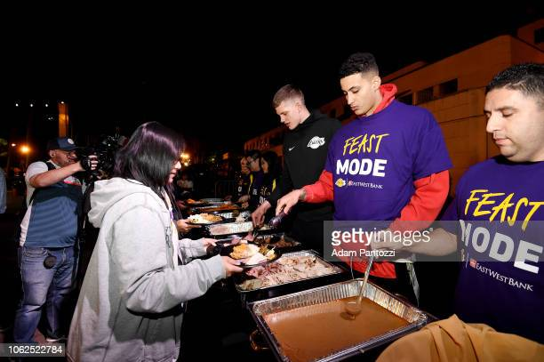 Moritz Wagner and Kyle Kuzma of the Los Angeles Lakers serves Thanksgiving dinner to guests from Los Angeles community organizations at Frank...