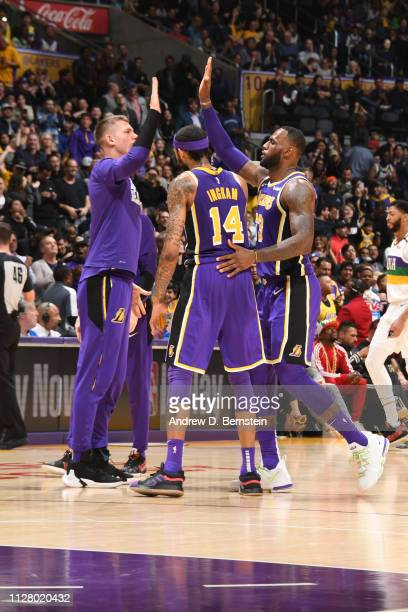 Moritz Wagner and LeBron James of the Los Angeles Lakers hifive during the game against the New Orleans Pelicans on February 27 2019 at STAPLES...