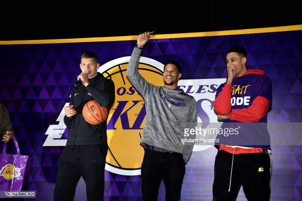 Moritz Wagner Josh Hart and Kyle Kuzma of the Los Angeles Lakers talks at the Thanksgiving dinner to guests from Los Angeles community organizations...