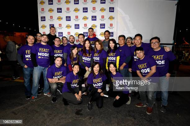 Moritz Wagner Kyle Kuzma and Josh Hart of the Los Angeles Lakers poses for a photo with fans at Thanksgiving dinner to guests from Los Angeles...