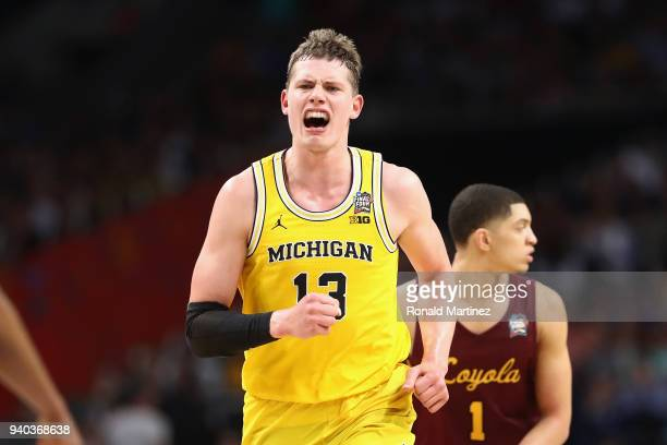 Moritz Wagner of the Michigan Wolverines celebrates after a play in the second half against the Loyola Ramblers during the 2018 NCAA Men's Final Four...