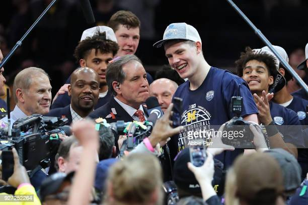 Moritz Wagner of the Michigan Wolverines celebrates after being named tournament MVP after defeating the Purdue Boilermakers 7566 during the...