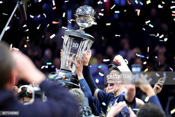 Moritz Wagner of the Michigan Wolverines celebrates after defeating the Purdue Boilermakers 7566 during the championship game of the Big 10...