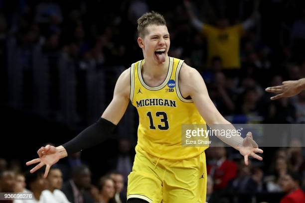 Moritz Wagner of the Michigan Wolverines celebrates after Wagner makes a threepointer in the first half against the Texas AM Aggies in the 2018 NCAA...