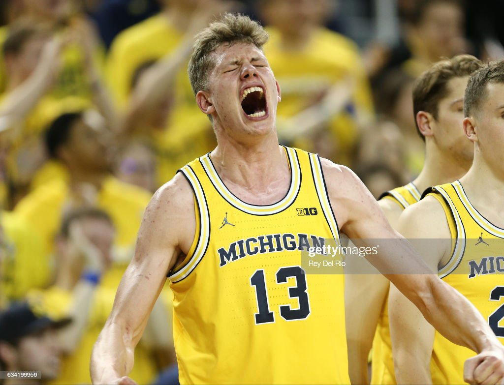 Moritz Wagner #13 of the Michigan Wolverines celebrates from the bench late in the second half against the Michigan State Spartans at Crisler Arena on February 7, 2017 in Ann Arbor, Michigan.