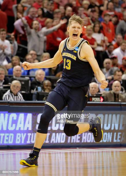 Moritz Wagner of the Michigan Wolverines celebrates their 7369 win over the Louisville Cardinals during the second round of the 2017 NCAA Men's...